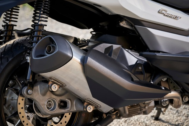 Close up shot of 2019 BMW C400 GT scooter exhaust and suspension