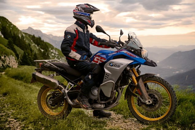 rider on BMW F850GS Adventure motorcycle stationary on mountain