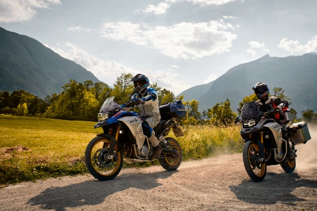 two BMW F850 GS motorcycles riding together