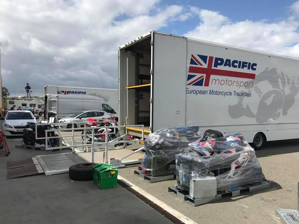 Pacific Motorsport transportation trucks unloading moto pallets