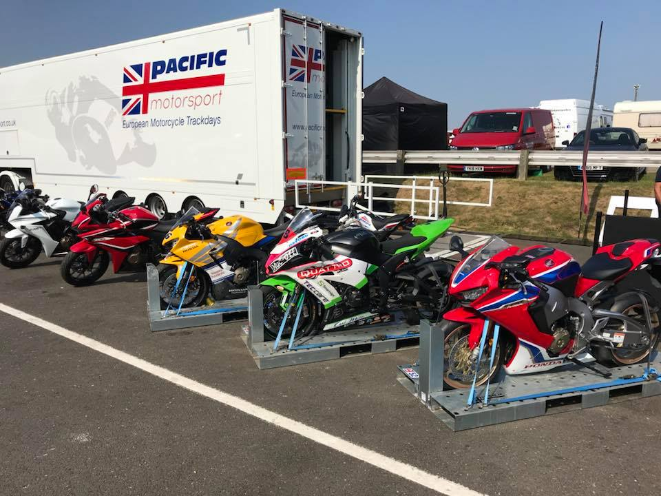 Motorcycles getting transported on moto pallets