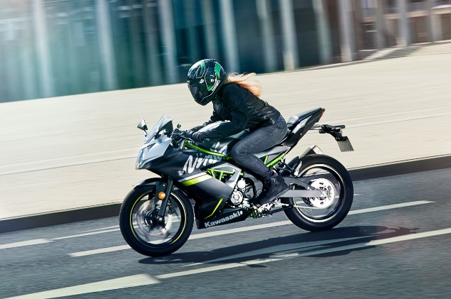 Motorcyclist riding the new 2019 Ninja 125 motorbike along bridge