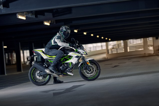 2019 Kawasaki Z125 motorcycle riding in multi-story carpark