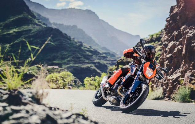 Orange KTM 690 Duke riding in mountains