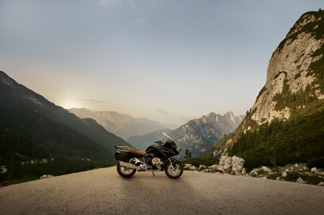 BMW R1250RT motorcycle on top of mountain with sunset