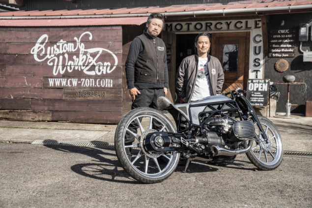Two Japansese motorcycle builders standing next to the BMW R18 cruiser motorcycle