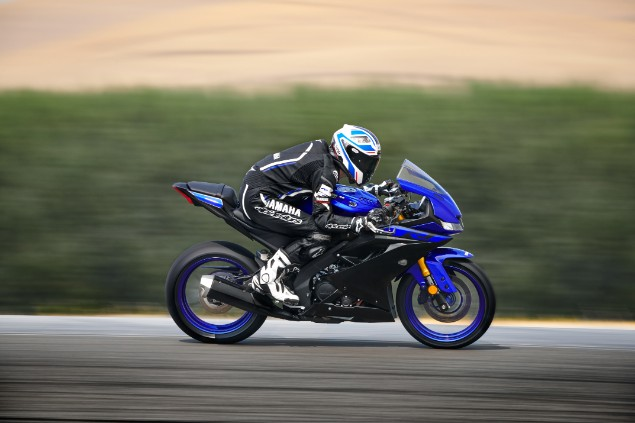 Blue 2019 Yamaha YZF-R125 motorcycle in action