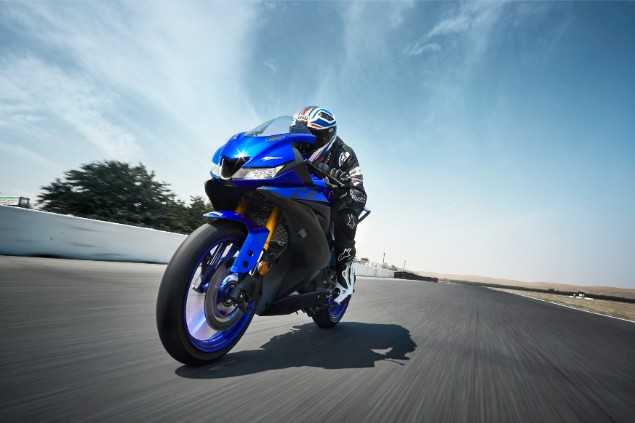 Blue 2019 Yamaha YZF-R125 motorcycle riding along racetrack