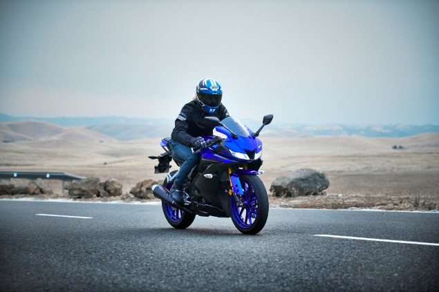 Dark blue 2019 Yamaha YZF-R125 motorcycle riding in the countryside