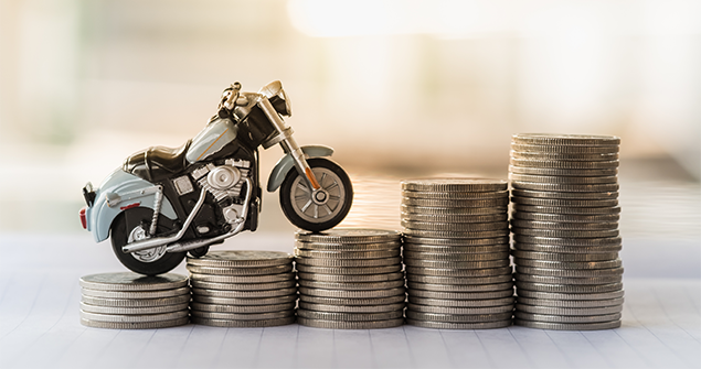 Motorcycle riding on top of money