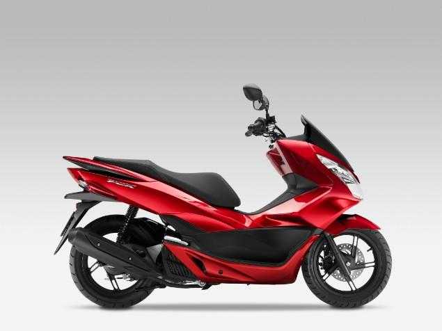 Red Honda PCX125 motorbike stationary