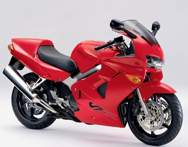 Red Honda VFR800 motorcycle stationary