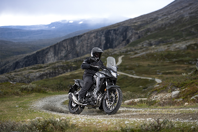 Black Honda CB500X motorbike riding in the mountain range