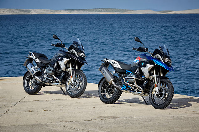 Two 2019 BMW R 1200-G motorcycles stationary next to lake