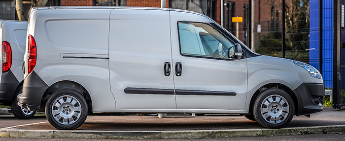 Van being used for business parked on the roadside