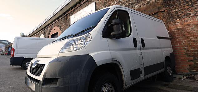 Van parked against wall
