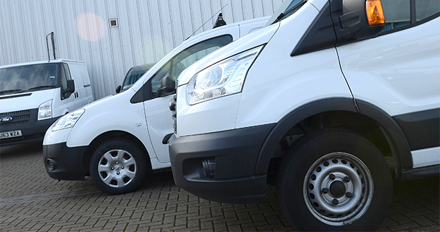 white-vans- parked