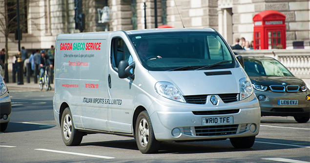silver-commerical-van-driving-on-road