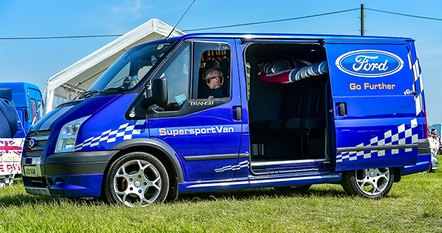 Ble ford transit mania supersport van stationary with doors open and people inside