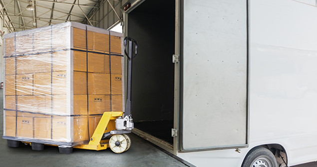 pallet truck loading boxes into van