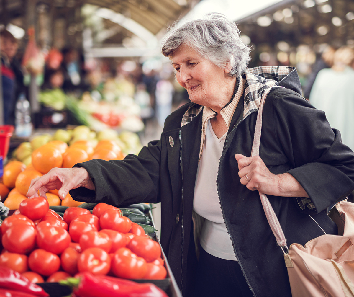 Senior woman shopping for produce