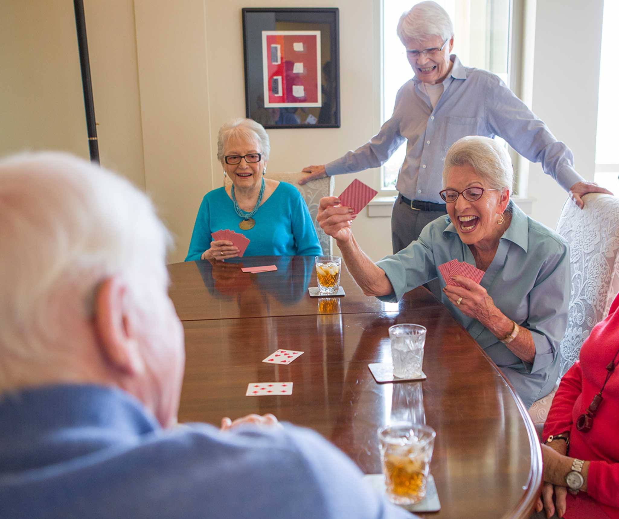 senior community residents play an exciting card game together