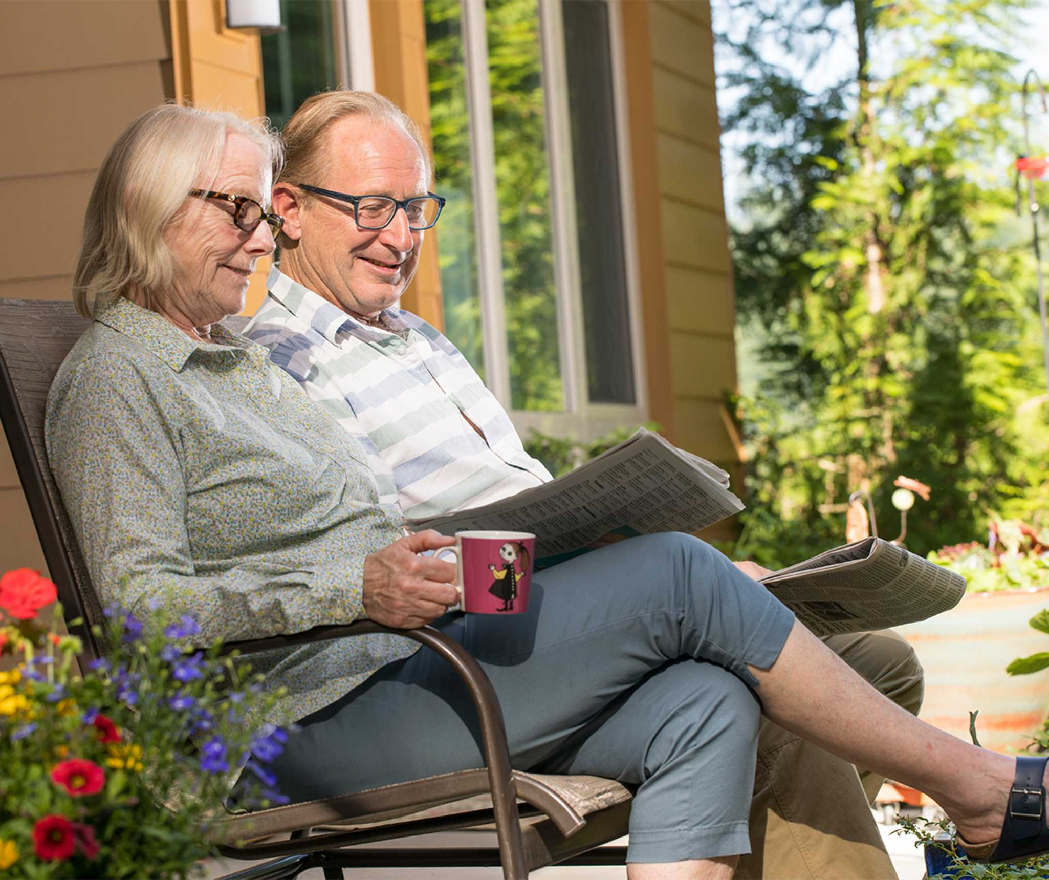 two seniors enjoy research for their senior living community