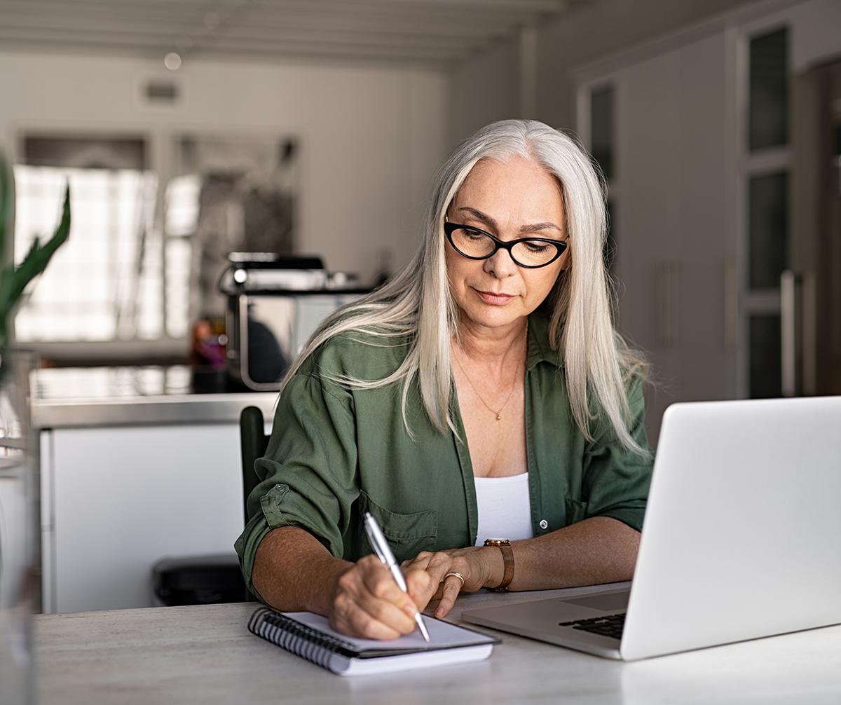Older woman writing something down