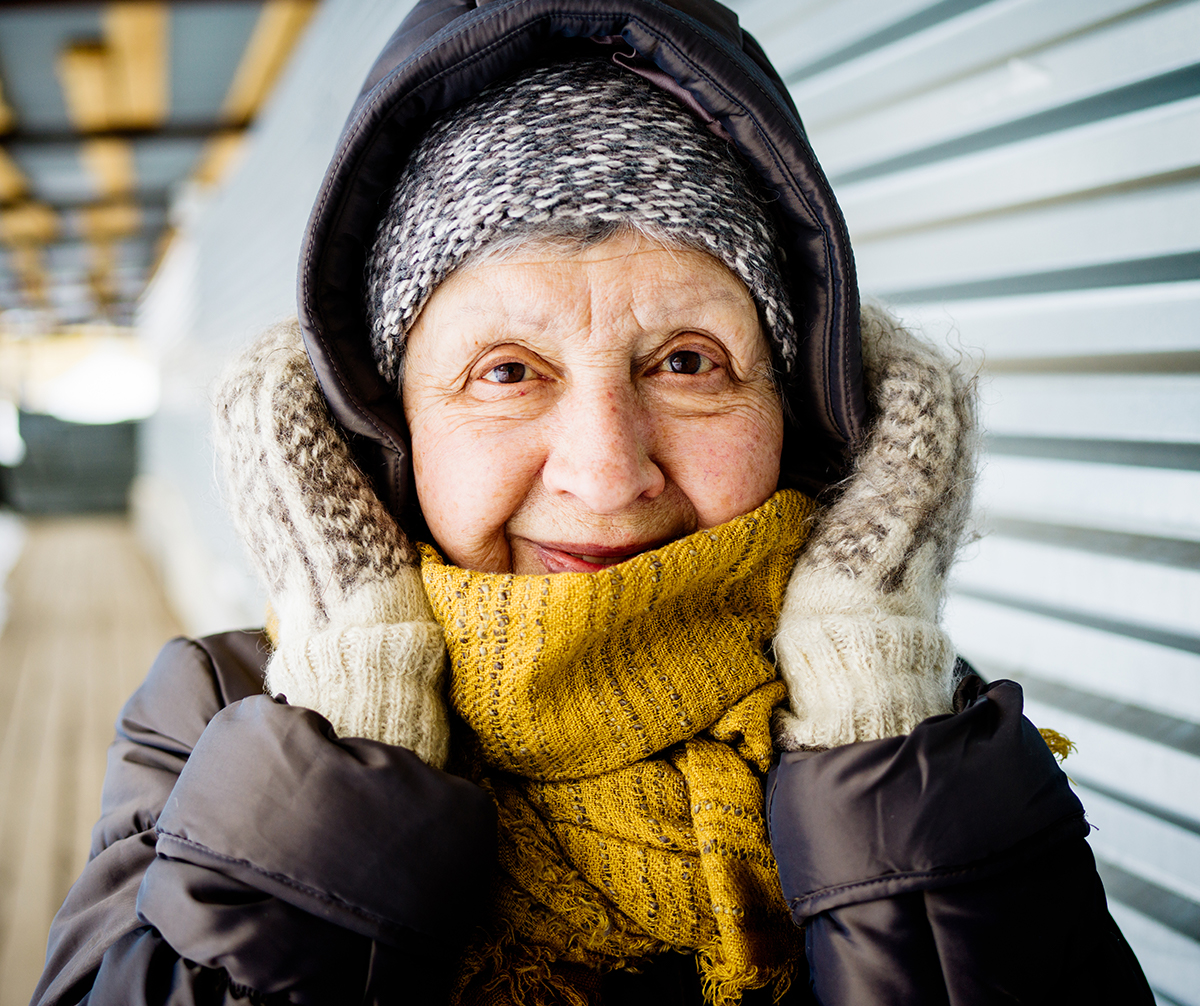 Elderly woman dressed in winter clothes
