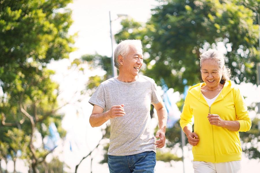 Happy senior jogging