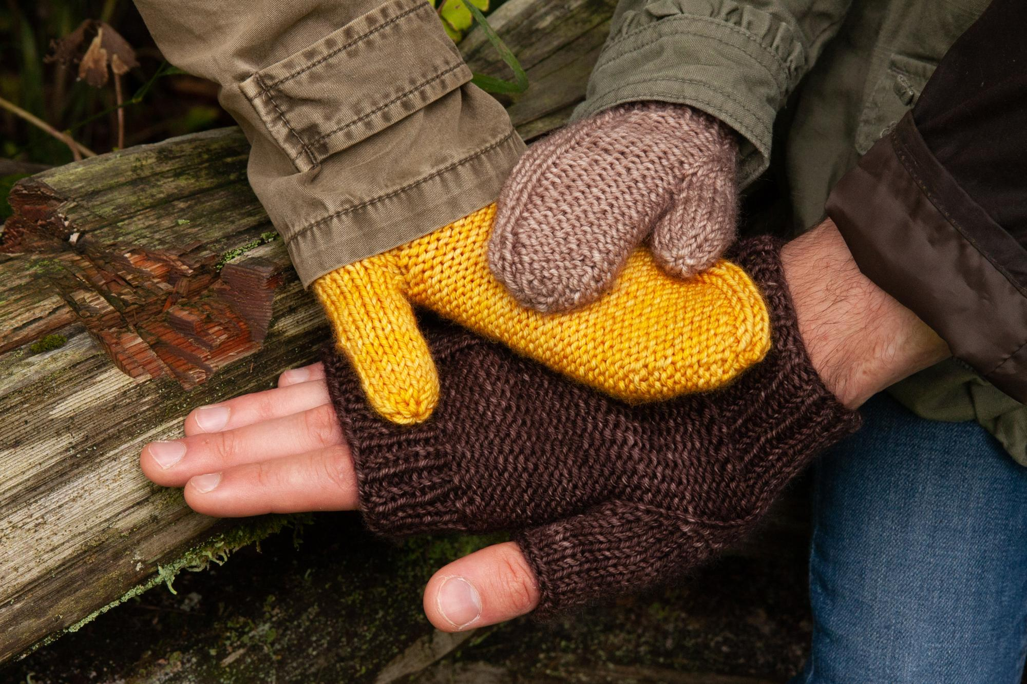 three hands in knit mittens and mitts