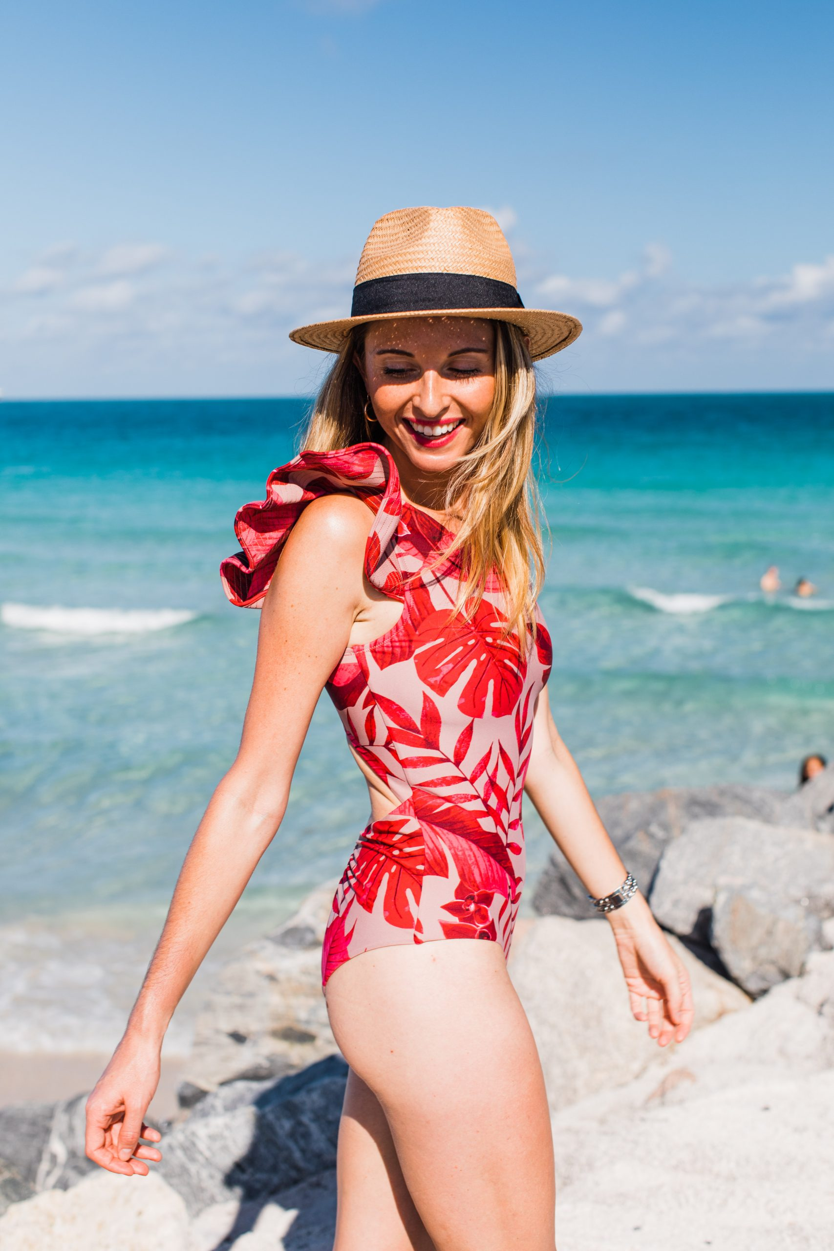 Tine Maria wearing ruffle one piece swimsuit bodysuit from Johanna Ortiz x H&M collaboration and H&M straw fedora hat on Miami Beach