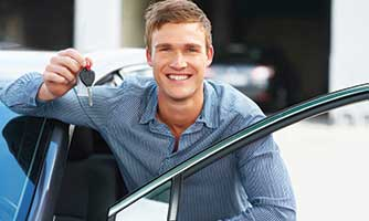 Man holding a key to a car