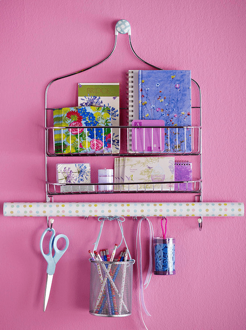 shower rack used to store school supplies on wall
