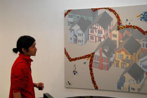 A guest having a moment alone with Nishizawa's 'Dreamy farm - c' (2007)