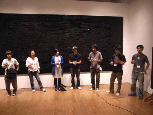 The artists introducing themselves at the opening. From left: Tomoko Iwata, Chika Kato, Ritsuko Yamashita, the two artists from Paramodel, Junji Shiotsu and Sohei Nishino.