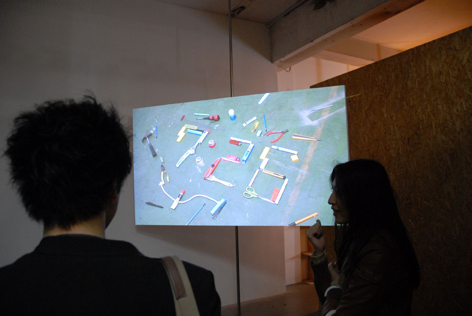 The centrepiece of this exhibition is Morita's video work, which shows everyday objects realigning to form digital numbers that count the passing time.