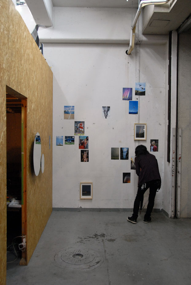 Hideki Aoyama collaborates with Schemata under the collective name 'happa', and they share the space, but tonight's opening is an Aoyama | Meguro production. Here, a visitor peers closely at Morita's collaged photography work.