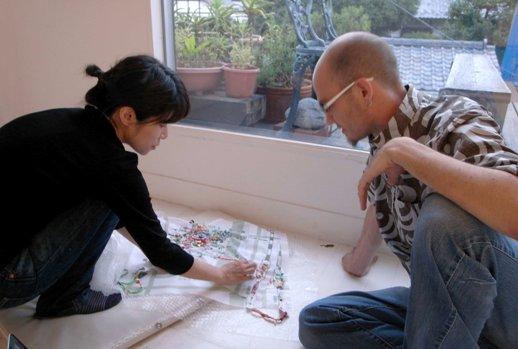 Sayaka Akiyama (left) explains her work to James Jack. Photo: Ryu Furusawa