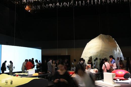 The opening reception Left: Hiroshi Sugimoto + Yuko Nagayama, 'No Line On The Horizon' (2009) Video 4'47'' Right: Mariko Mori + Kengo Kuma, 'White Hole' (2011) Acrylic, LED, steel, 2392 x 2772 x 653mm Front: Anish Kapoor's maquettes