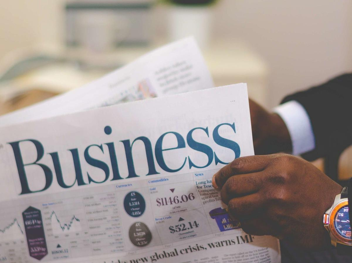 person-holding-white-and-blue-business-paper-936137.jpg