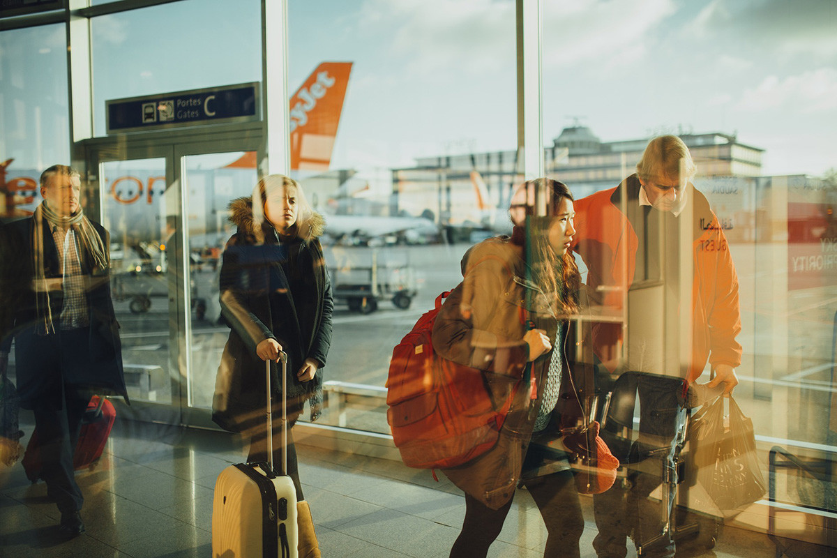 tourists and travellers at the airport