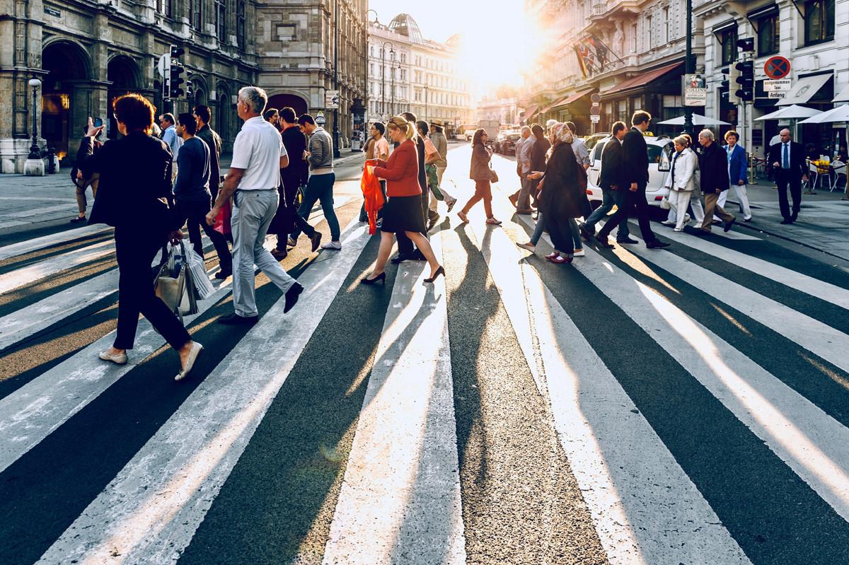 people walking through the street