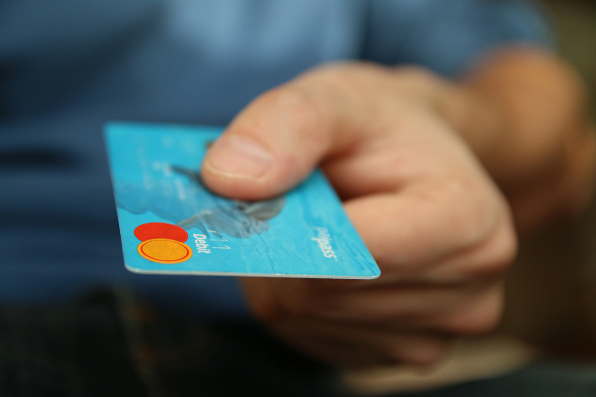 person paying with a credit card