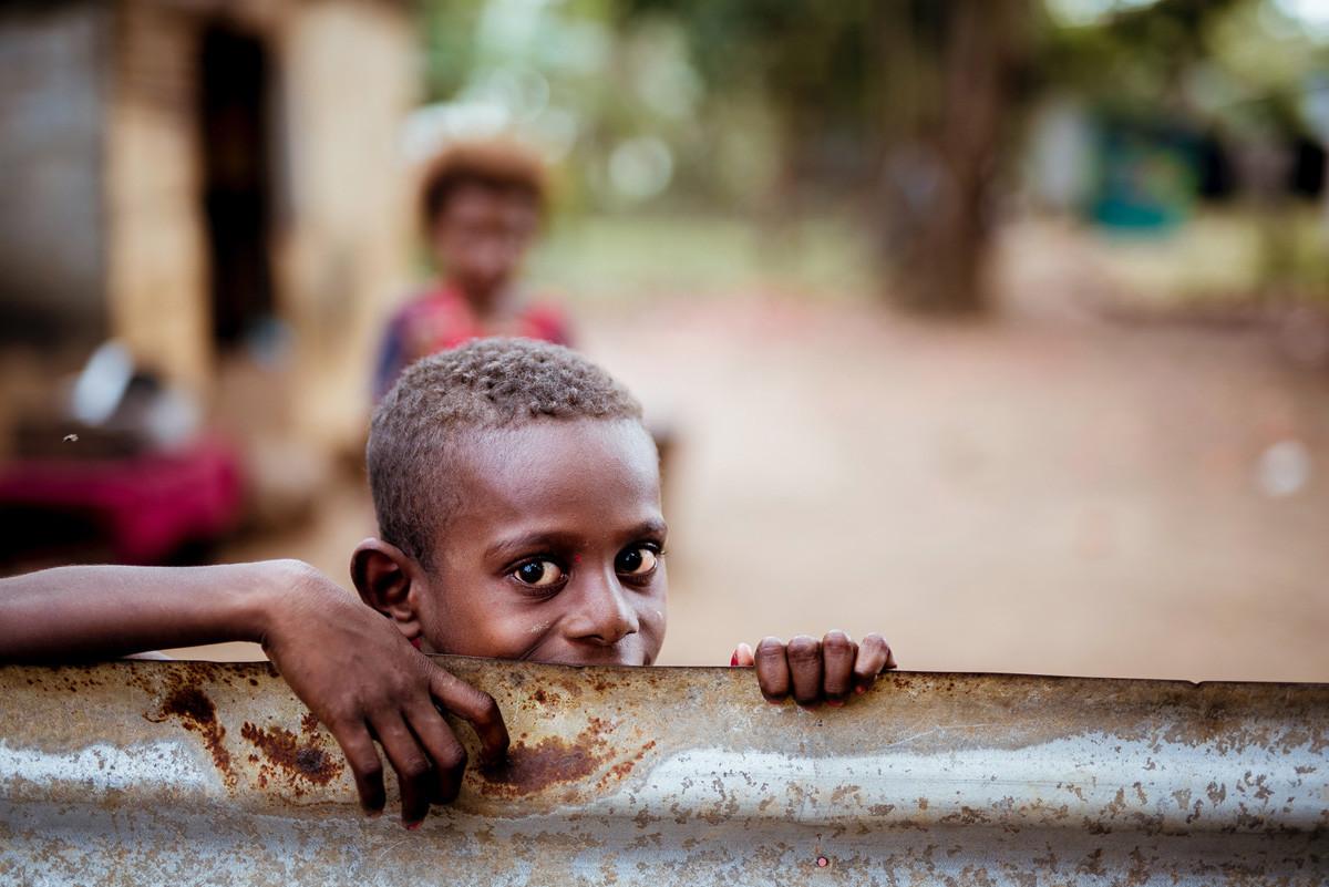 child grabbing a steel barrier