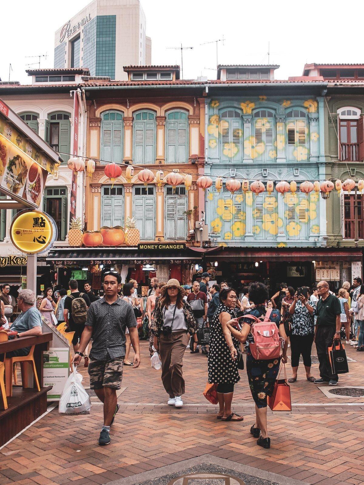 People walking at a Singaporean street.
