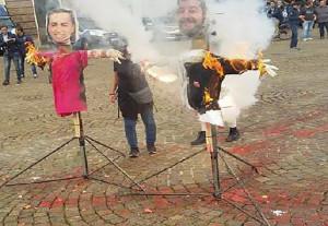 Fermati in tre per aver bruciato i fantocci di Salvini e Di Maio