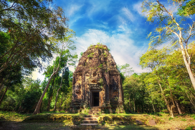 Day 9   220864246 sambor prei kuk temple ruins with giant banyan trees under blue sky