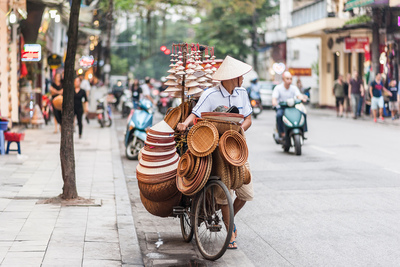 Day 1   1194338164 vietnam street vendor with a bicycle on the streets of hanoi