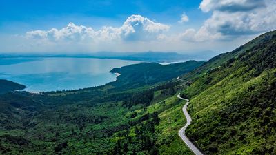 Day 9   1358400890 vietnam danang the hai van pass. a beautiful road to drive by motorbike  very nice curves